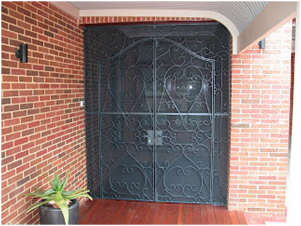 Custom made steel door that is powder coated to match window frames