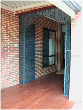 Custom steel doors that are open to show entrance